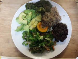 A sample meal with beans, avocado, bitter melon, squash, greens, and buckwheat